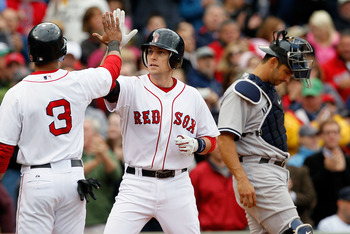 BOSTON - OCTOBER 3:  Jed Lowrie #12 of  the Boston Red Sox crosses home after hitting a home run against the New York Yankees at Fenway Park, October 3, 2010, in Boston, Massachusetts. (Photo by Jim Rogash/Getty Images)