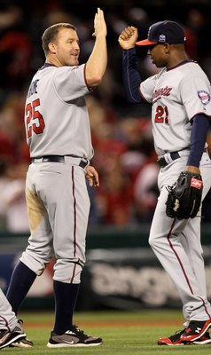 ANAHEIM, CA - APRIL 08:  Jim Thome #25 of the Minnesota Twins celebrates with Delmon Young #21 after the game against the Los Angeles Angels of Anaheim on April 8, 2010 at Angel Stadium in Anaheim, California.  (Photo by Stephen Dunn/Getty Images)