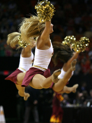 MIAMI - MARCH 22: The cheerleaders of the Arizona State Sun Devils fly through the air during their game against the Syracuse Orange during the second round of the NCAA Division I Men's Basketball Tournament at the American Airlines Arena on March 22, 200