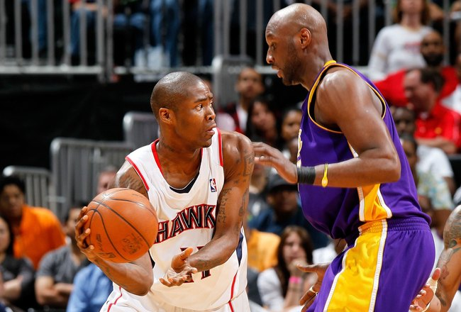 ATLANTA - MARCH 31:  Jamal Crawford #11 of the Atlanta Hawks against Lamar Odom #7 of the Los Angeles Lakers at Philips Arena on March 31, 2010 in Atlanta, Georgia.  NOTE TO USER: User expressly acknowledges and agrees that, by downloading and/or using th