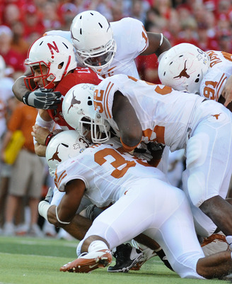 LINCOLN, NE - OCTOBER 16: Quarterback Zac Lee #5 of the Nebraska Cornhuskers is tackled by the Texas longhorn defense during second half action of their game at Memorial Stadium on October 16, 2010 in Lincoln, Nebraska. Texas Defeated Nebraska 20-13. (Pho
