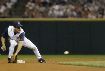 CLEVELAND, OH - SEPTEMBER 5:  Shortstop Omar Vizquel #13 of the Anaheim Angels fields the ball during the game against the Cleveland Indians on September 5, 2004 at Jacobs Field in Cleveland, Ohio. The Angels defeated the Indians 2-1.  (Photo by David Max