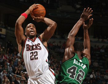 MILWAUKEE - APRIL 08: Michael Redd #22 of the Milwaukee Bucks is fouled while shooting by Tony Allen #45 of the Boston Celtics on April 8, 2008 at the Bradley Center in Milwaukee, Wisconsin. The Celtics defeated the Bucks 107-104 in overtime. NOTE TO USER