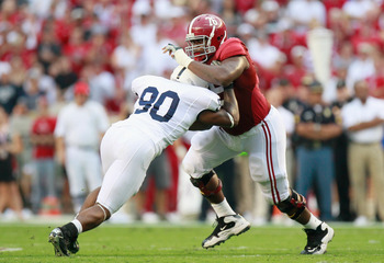 TUSCALOOSA, AL - SEPTEMBER 11:  D.J. Fluker #76 of the Alabama Crimson Tide against Sean Stanley #90 of the Penn State Nittany Lions at Bryant-Denny Stadium on September 11, 2010 in Tuscaloosa, Alabama.  (Photo by Kevin C. Cox/Getty Images)