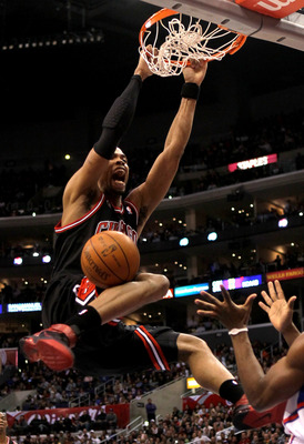 LOS ANGELES, CA - FEBRUARY 02:  Taj Gibson #22 of the Chicago Bulls dunks against the Los Angeles Clippers at Staples Center on February 2, 2011  in Los Angeles, California.  NOTE TO USER: User expressly acknowledges and agrees that, by downloading and or