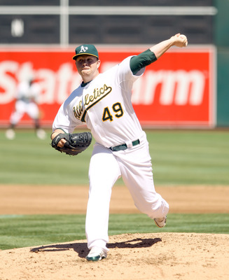 OAKLAND, CA - SEPTEMBER 06:  Brett Anderson #49 of the Oakland Athletics pitches against the Seattle Mariners at the Oakland-Alameda County Coliseum on September 6, 2010 in Oakland, California.  (Photo by Ezra Shaw/Getty Images)