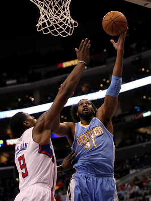 LOS ANGELES, CA - JANUARY 5:  Nene #31 of the Denver Nuggets shoots over DeAndre Jordan #9 of the Los Angeles Clippers at Staples Center on January 5, 2011  in Los Angeles, California.  NOTE TO USER: User expressly acknowledges and agrees that, by downloa