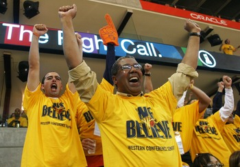OAKLAND, CA - MAY 11:  Fans of the Golden State Warriors celebrate against the Utah Jazz in Game Three of the Western Conference Semifinals during the 2007 NBA Playoffs on May 11, 2007 at Oracle Arena in Oakland, California.  NOTE TO USER: User expressly