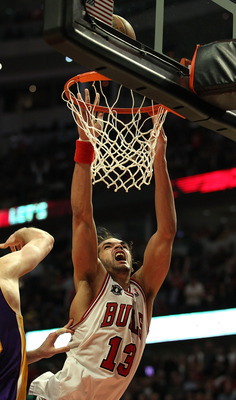 CHICAGO, IL - DECEMBER 10: Joakim Noah #13 of the Chicago Bulls puts up a shot against the Los Angeles Lakers at the United Center on December 10, 2010 in Chicago, Illinois. The Bulls defeated the Lakers 88-84. NOTE TO USER: User expressly acknowledges an