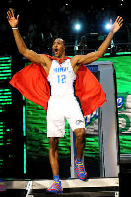 PHOENIX - FEBRUARY 14:  Dwight Howard of the Orlando Magic emerges from a phone booth wearing a Superman cape during the Sprite Slam Dunk Contest on All-Star Saturday Night, part of 2009 NBA All-Star Weekend at US Airways Center on February 14, 2009 in Ph