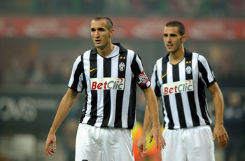 MILAN, ITALY - OCTOBER 03:  Giorgio Chiellini and Leonardo Bonucci of Juventus FC during the Serie A match between FC Internazionale Milano and Juventus FC at Stadio Giuseppe Meazza on October 3, 2010 in Milan, Italy.  (Photo by Claudio Villa/Getty Images
