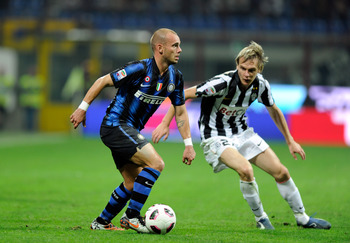 MILAN, ITALY - OCTOBER 03:  Wesley Sneijder of Inter Milan and Milos Krasic of Juventus FC during the Serie A match between FC Internazionale Milano and Juventus FC at Stadio Giuseppe Meazza on October 3, 2010 in Milan, Italy.  (Photo by Claudio Villa/Get