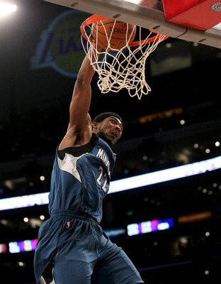 LOS ANGELES - NOVEMBER 9:  Corey Brewer #22 of the Minnesota Timberwolves dunks against the Los Angeles Lakers at Staples Center on November 9, 2010 in Los Angeles, California. The Lakers won 99-94.   NOTE TO USER: User expressly acknowledges and agrees t
