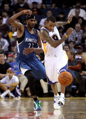 OAKLAND, CA - DECEMBER 14:  Monta Ellis #8 of the Golden State Warriors and Corey Brewer #22 of the Minnesota Timberwolves go for the ball at Oracle Arena on December 14, 2010 in Oakland, California.  NOTE TO USER: User expressly acknowledges and agrees t