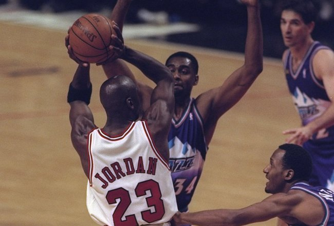 10 Jun 1998:  Michael Jordan #23 of the Chicago Bulls in action against Chris Morris and Howard Eisley of the Utah Jazz during the NBA Finals Game 4 at the United Center in Chicago, Illinois.  The Bulls defeated the Jazz 86-82. Mandatory Credit: Jonathan