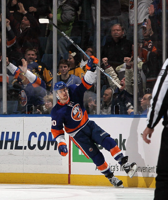 UNIONDALE, NY - FEBRUARY 11:  Michael Grabner #40 of the New York Islanders celebrates his second goal against the Pittsburgh Penguins on February 11, 2011 at Nassau Coliseum in Uniondale, New York. The Isles defeated the Pens 9-3.  (Photo by Jim McIsaac/