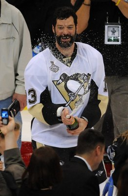 DETROIT - JUNE 12:  Bill Guerin #13 of the Pittsburgh Penguins sprays sparkling wine after Game Seven of the 2009 NHL Stanley Cup Finals against the Detroit Red Wings at Joe Louis Arena on June 12, 2009 in Detroit, Michigan. The Penguins defeated the Red