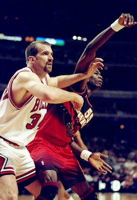 13 Feb 1998:  Center Dikembe Mutombo of the Atlanta Hawks (right) in action against center Bill Wennington of the Chicago Bulls during a game at the United Center in Chicago, Illinois.  The Bulls defeated the Hawks 112-110. Mandatory Credit: Jonathan Dani