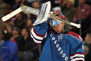 DENVER, CO - JANUARY 20:  Goalie Craig Anderson #41 of the Colorado Avalanche puts on his mask as he defends the goal against the Nashville Predators at the Pepsi Center on January 20, 2011 in Denver, Colorado.  (Photo by Doug Pensinger/Getty Images)