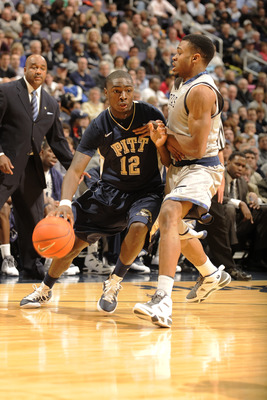 WASHINGTON, DC- JANUARY 12:  Ashton Gibbs #12 of the Pittsburgh Panthers dribbles around Vee Sanford #11 of the Georgetown Hoyas during a college basketball game on January 12, 2011 at the Verizon Center in Washington, DC.  The Panthers won 72-57.  (Photo