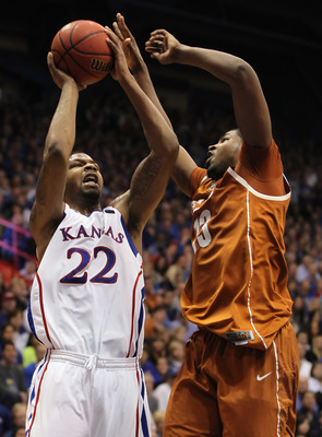 LAWRENCE, KS - JANUARY 22:  Marcus Morris #22 of the Kansas Jayhawks shoots over Tristan Thompson #13 of the Texas Longhorns during the game on January 22, 2011 at Allen Fieldhouse in Lawrence, Kansas.  (Photo by Jamie Squire/Getty Images)