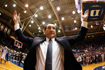 DURHAM, NC - FEBRUARY 09:  Head coach Mike Krzyzewski of the Duke Blue Devils celebrates with fans after defeating the North Carolina Tar Heels 79-73 at Cameron Indoor Stadium on February 9, 2011 in Durham, North Carolina.  (Photo by Streeter Lecka/Getty
