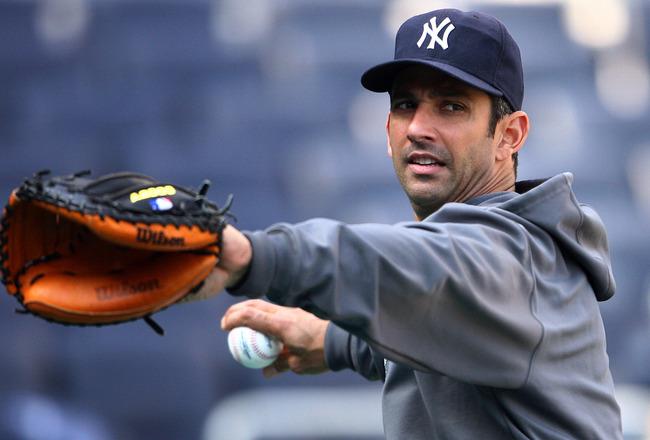 NEW YORK - OCTOBER 12:  Jorge Posada #20 of the New York Yankees throws a ball during a workout session at Yankee Stadium on October 12, 2010 in the Bronx borough of New York City.  (Photo by Andrew Burton/Getty Images)