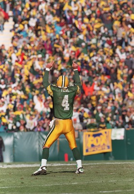 3 Nov 1996:  Quarterback Brett Favre of the Green Bay Packers celebrates a touchdown during the Packers 28-18 win over the Detroit Lions at Lambeau Field in Green Bay, Wisconsin. Mandatory Credit: Stephen Dunn/Allsport
