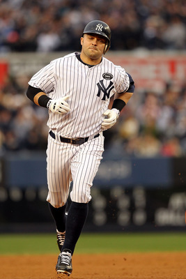 NEW YORK - OCTOBER 20:  Nick Swisher #33 of the New York Yankees runs the bases on his solo home run in the bottom of the third inning against the Texas Rangers in Game Five of the ALCS during the 2010 MLB Playoffs at Yankee Stadium on October 20, 2010 in