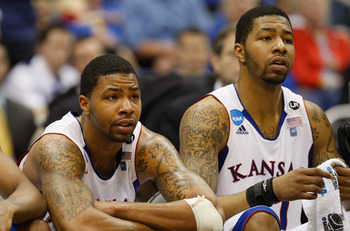 SAN ANTONIO, TX - MARCH 27:  Marcus Morris #22 and Markieff Morris #21 of the Kansas Jayhawks react during the southwest regional final of the 2011 NCAA men's basketball tournament at the Alamodome on March 27, 2011 in San Antonio, Texas. Virginia Commonw