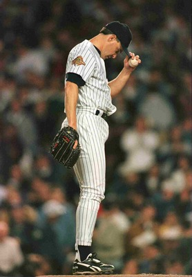 26 Oct 1996:  Pitcher Jimmy Key of the New York Yankees contemplates his walked in run for the Atlanta Braves in the fourth inning of game 6 in the World Series at Yankee Stadium in New York, New York. Mandatory Credit: Doug Pensinger/Allsport