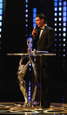 "ABU DHABI, UNITED ARAB EMIRATES - FEBRUARY 07:  Rafael Nadal of Spain speaks after receiving his award for ""Laureus World Sportsman of the Year""  during the award ceremony for the 2011 Laureus World Sports Awards at the Emirates Palace on February 7, 2011"