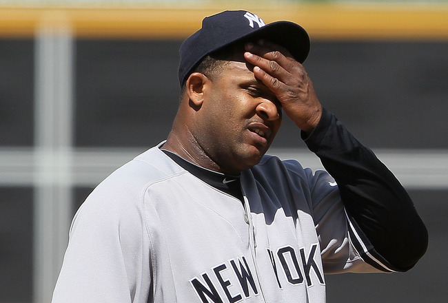 OAKLAND, CA - APRIL 22:  C.C. Sabathia #52 of the New York Yankees wipes his forehead during the eighth inning against the Oakland Athletics at the Oakland-Alameda County Coliseum on April 22, 2010 in Oakland, California. The Athletics defeated the Yankee