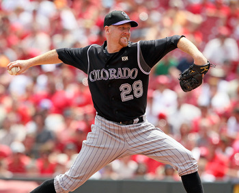 CINCINNATI - JULY 18:  Aaron Cook #28 of the Colorado Rockies throws a pitch during the game against the Cincinnati Reds at Great American Ball Park on July 18, 2010 in Cincinnati, Ohio.  (Photo by Andy Lyons/Getty Images)