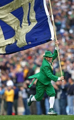 SOUTH BEND, IN - OCTOBER 03: The leprechaun mascot for the Notre Dame Fighting Irish runs onto the field with a flag before a game against the Washington Huskies on October 3, 2009 at Notre Dame Stadium in South Bend, Indiana. Notre Dame defeated Washingt