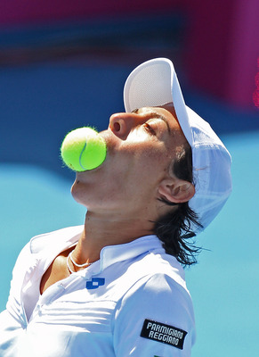 HOBART, AUSTRALIA - FEBRUARY 06:  Francesca Schiavone of Italy bites a tennis ball after putting it in her mouth during her match against Samantha Stosur of Australia during day two of the Federation Cup tie between Australia and Italy at the Domain Tenni
