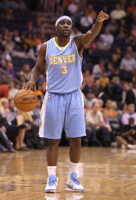 PHOENIX - OCTOBER 22:  Ty Lawson #3 of the Denver Nuggets handles the ball during the preseason NBA game against the Phoenix Suns at US Airways Center on October 22, 2010 in Phoenix, Arizona. NOTE TO USER: User expressly acknowledges and agrees that, by d