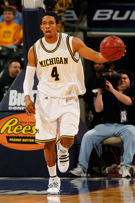 INDIANAPOLIS - MARCH 11:  Guard Darius Morris #4 of the Michigan Wolverines drives with the ball against the Iowa Hawkeyes during the first round of the Big Ten Men's Basketball Tournament at Conseco Fieldhouse on March 11, 2010 in Indianapolis, Indiana.