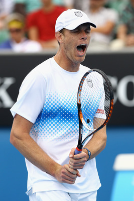 MELBOURNE, AUSTRALIA - JANUARY 17:  Sam Querrey of the United States of America reacts after a point in his first round match against Lukasz Kubot of Poland during day one of the 2011 Australian Open at Melbourne Park on January 17, 2011 in Melbourne, Aus
