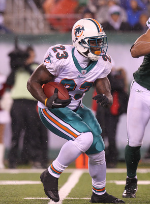 EAST RUTHERFORD, NJ - DECEMBER 12:  Ronnie Brown #23 of the Miami Dolphins rushes against the New York Jets at New Meadowlands Stadium on December 12, 2010 in East Rutherford, New Jersey.  (Photo by Nick Laham/Getty Images)