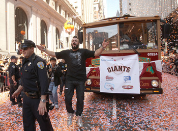 SAN FRANCISCO - NOVEMBER 03:  Pitcher Brian Wilson of the San Francisco Giants runs down the street during the San Francisco Giants victory parade on November 3, 2010 in San Francisco, California.  (Photo by Ezra Shaw/Getty Images)