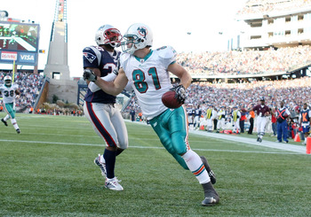 FOXBORO, MA - NOVEMBER 08:  Joey Haynos #81 of the Miami Dolphins celebrates his touchdown as Brandon McGowan #30 of the New England Patriots defends on November 8, 2009 at Gillette Stadium in Foxboro, Massachusetts. The Patriots defeated the Dolphins 27-