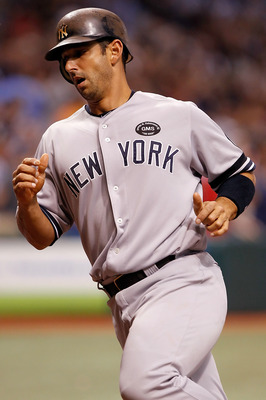 ST. PETERSBURG - SEPTEMBER 14:  Catcher Jorge Posada #20 of the New York Yankees rounds the bases after his pinch hit tenth-inning game-winning home run against the Tampa Bay Rays at Tropicana Field on September 14, 2010 in St. Petersburg, Florida.  (Phot