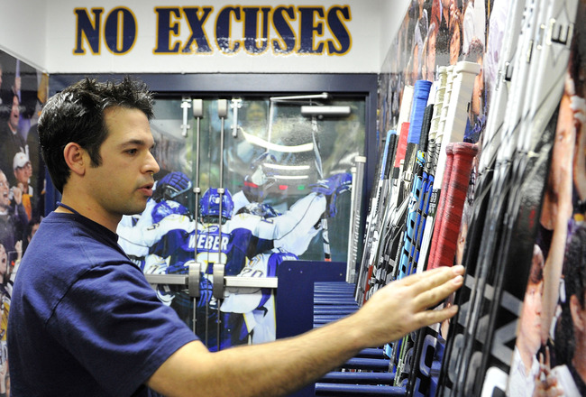 NASHVILLE, TN - OCTOBER 28:  Jeff Camelio, assistant equipment manager for the Nashville Predators, prepares sticks prior to a game against the St. Louis Blues on October 28, 2010 at Bridgestone Arena in Nashville, Tennessee.  (Photo by Frederick Breedon/