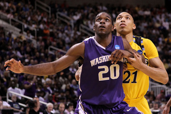 SAN JOSE, CA - MARCH 18:  Quincy Pondexter #20 of the Washington Huskies fights for position against Joseph Fulce #21 of the Marquette Golden Eagles during the first round of the 2010 NCAA men's basketball tournament at HP Pavilion on March 18, 2010 in Sa