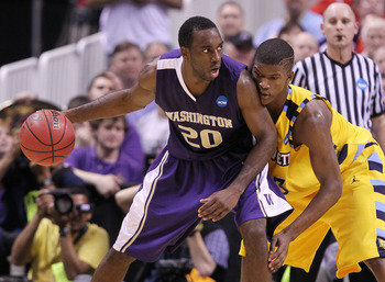 SAN JOSE, CA - MARCH 18:  Quincy Pondexter #20 of the Washington Huskies looks to move the ball against the Marquette Golden Eagles during the first round of the 2010 NCAA men's basketball tournament at HP Pavilion on March 18, 2010 in San Jose, Californi