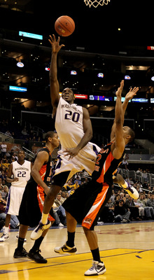 LOS ANGELES - MARCH 11: Quincy Pondexter #20 of the Washington Huskies shoots over Calvin Haynes #22 of the Oregon State Beavers during the quarterfinals of the Pac-10 Basketball Tournament at Staples Center on March 11, 2010 in Los Angeles, California.