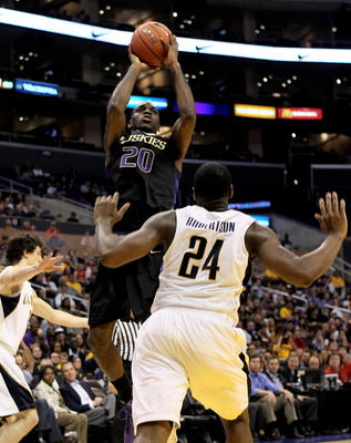 LOS ANGELES, CA - MARCH 13:  Quincy Pondexter #20 of the Washington Huskies shoots over Theo Robertson #24 of the California Golden Bears during the championship game of the Pac-10 Basketball Tournament at Staples Center on March 13, 2010 in Los Angeles,