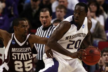 PORTLAND, OR - MARCH 19:  Quincy Pondexter #20 of the Washington Huskies posts up Phil Turner #25 of the Mississippi State Bulldogs during the first round of the NCAA Division I Men's Basketball Tournament at the Rose Garden on March 19, 2009 in Portland,