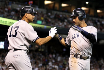 PHOENIX - JUNE 23:  Derek Jeter #2 of the New York Yankees is congratulated by teammate Alex Rodriguez #13 after Jeter scored a run against the Arizona Diamondbacks during the first inning of the Major League Baseball game at Chase Field on June 23, 2010